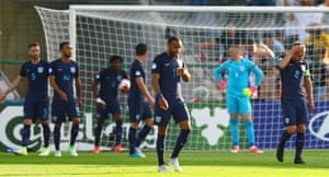 The England players look dejected after conceding the opening goal, a header from Chrien.