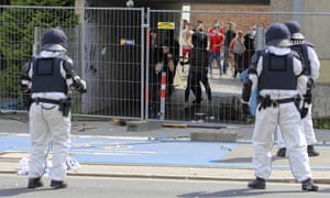 A stone is thrown at police officers standing in front of the residential complex on Groner Landstrasse, which is completely quarantined in Goettingen, Germany, Saturday, 20 June 2020.