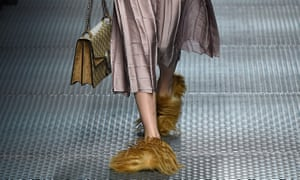 A model takes the Gucci princetown slippers for a walk at Milan fashion week autumn/winter 2015.