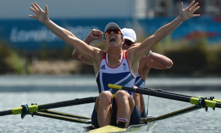 Rowers Katherine Grainger and Anna Watkins celebrate victory at the London 2012 Olympic Games.