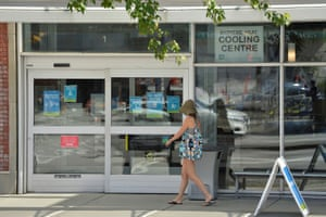 A woman enters a cooling centre as temperatures soar in Vancouver. The sweltering heatwave that has settled over western Canada for several days is believed to be a contributing factor in dozens of sudden-death calls received by police in the city