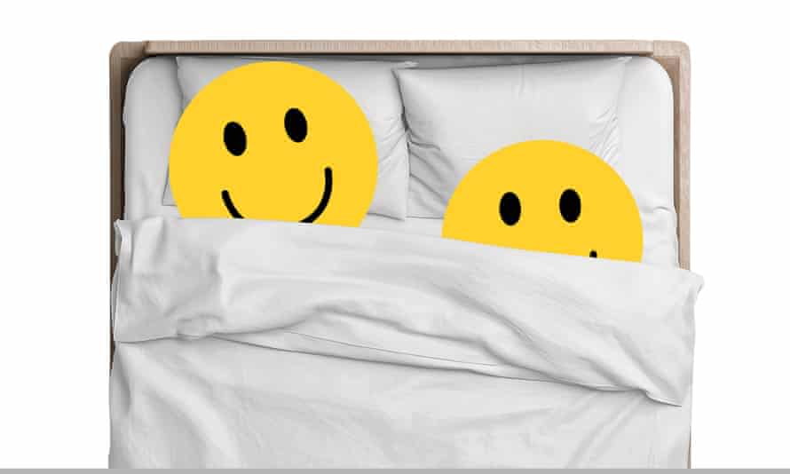 Two smiley faces in bed together