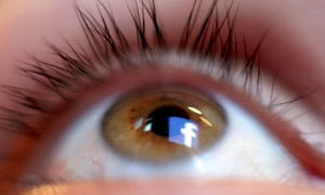 a facebook logo reflected in the human eye