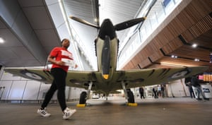 London, UK A British second world war Spitfire fighter plane on display at London Bridge station to commemorate the 75th anniversary of D-Day, the WWII allied landings and the Battle of Normandy
