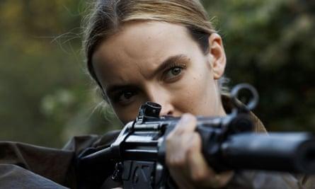 Jodie Comer as Killing Eve's Villanelle, a female assassin created from Luke Jennings's self-published short novels.
