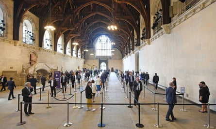 Line of duty: MPs line up to vote at the House of Commons last month.