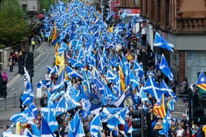 People march through Glasgow waving the Saltire
