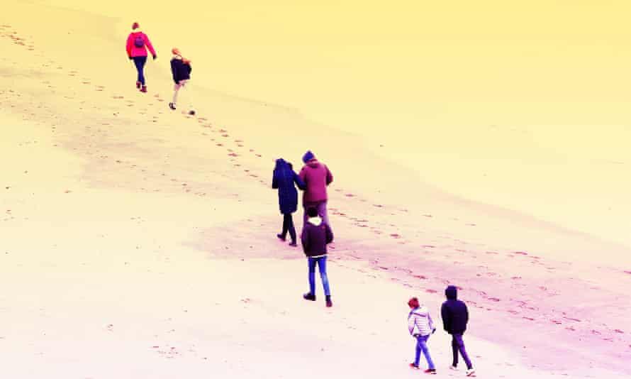 People walk on Broadstairs beach, Kent, March 2020.