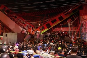 Mexican television and social media showed train cars hanging in mid-air as sirens blared nearby