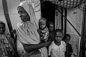 Hanwa holds her malnourished 13-month-old, Halima