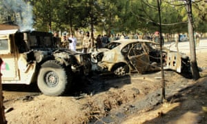 Vehicles damaged by a suicide bomb attack in Helmand