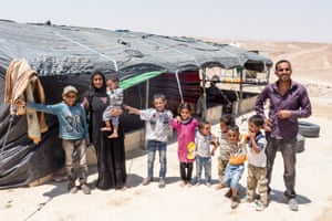 Farhan Ali Awdeh with members of his family in al-Rashayda, a settlement in area C of the West Bank