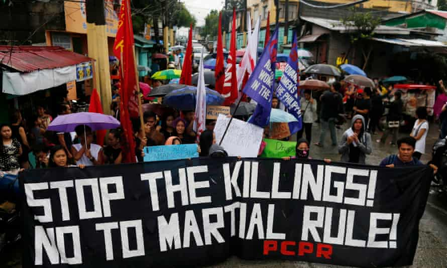 Protesters hold placards and a banner calling for justice for student Kian Loyd delos Santos at a wake in Kaloocan city, north of Manila.