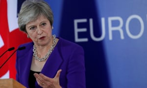 Theresa May holds a news conference at the EU leaders summit in Brussels.