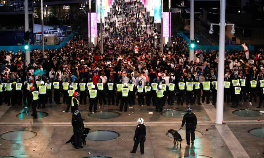 Police form a cordon around England fans outside Wembley before the Euro 2020 final.
