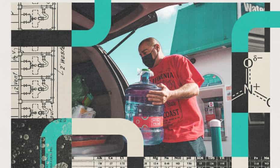 man carries water jug