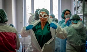 Medical workers get ready for a shift treating coronavirus patients in Moscow