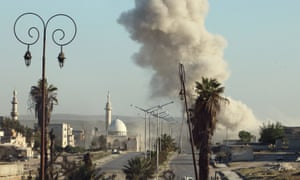 Smoke rises after an airstrike in a rebel-held area of Aleppo
