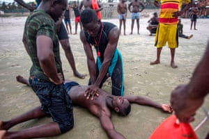 Lifeguards train in cardiopulmonary resuscitation (CPR)