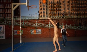 Charlie Gilmour playing basketball naked on Brighton seafront