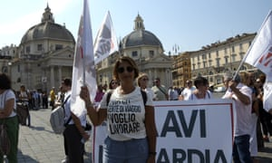 A protester holds up a flag during the travel agents' protest in Rome. Protesters gathered at Piazza del Popolo requesting government for tax incentives. Since the start of the Covid-19 epidemic, 35% of travel agencies in Italy have closed definitively.