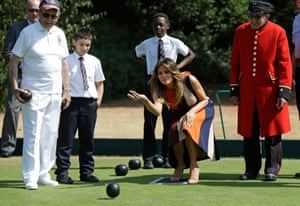 Melania Trump tries her hand at bowls in the grounds of the Royal Hospital Chelsea in London