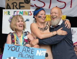 Festival founder Michael Eavis is joined by Rachel Rousham from the White Ribbon Alliance and members of the Avalonian Choir for a pro-feminist event organised by the White Ribbon Alliance
