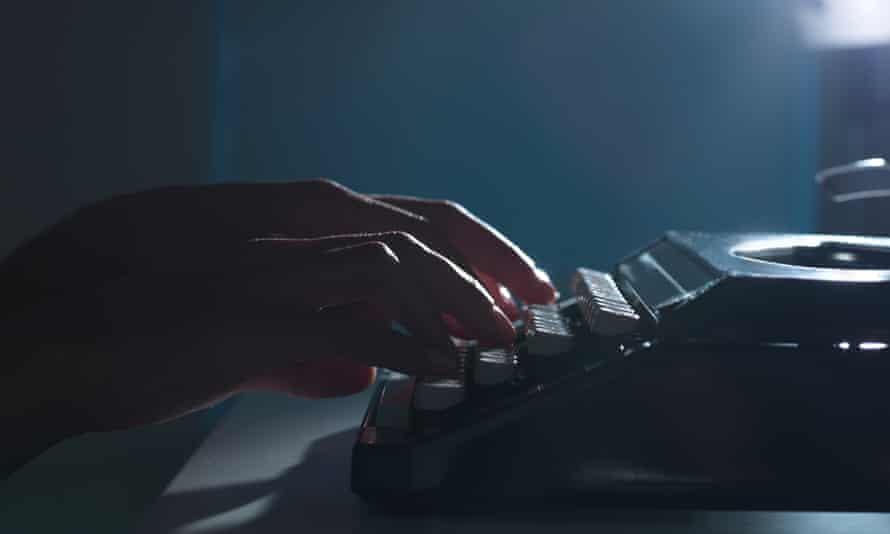 Close up of hands using typewriter