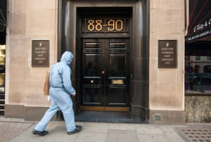A police forensics officer enters the Hatton Garden Safe Deposit company, scene of the biggest burglary in English history.