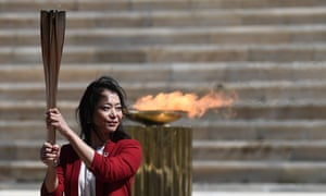 Former Japanese swimmer Imoto Naoko holds the Olympic torch during a handover ceremony in Athens on Thursday.
