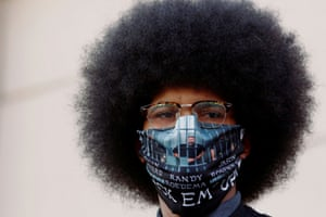 Aurora, US A protester wears a mask identifying the the officers who arrested Elijah McClain. McClain died in police custody