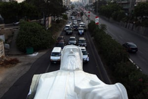 A statue of Lebanese Christian Maronite monk Saint Charbel, weighing 40 tonne, being transported on the Jounieh highway