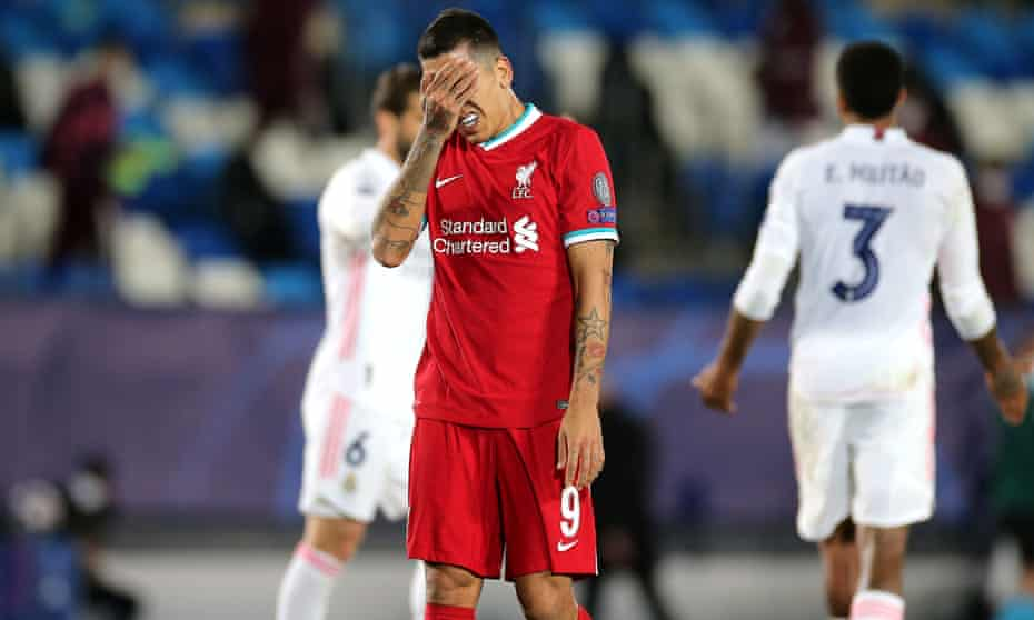 Roberto Firmino, who did not start against Real Madrid, contemplates Liverpool's defeat in midweek.