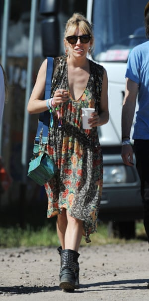 Another favourite of the boho crowd, Sienna Miller wore a floral frock and biker boots to Glastonbury in 2013.