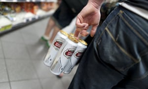 four pint cans of Stella Artois held together by a pack ring and being carried by a young man in a shop