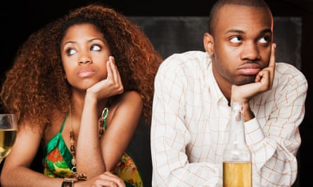 Couple sitting looking fed up