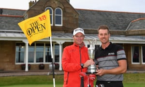 Henrik Stenson, right, and his caddie Gareth Lord hold the Claret Jug after the Swede's Open 2016 win at Royal Troon.