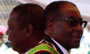 The prime minister, Morgan Tsvangirai, and president, Robert Mugabe, at a rally to mark Zimbabwe's 31st anniversary of independence in 2011.