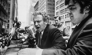 Norman Mailer speaks into a microphone during his campaign for New York City mayor, June 1969.