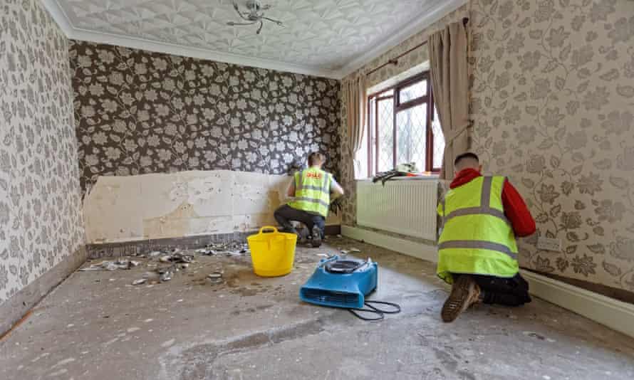 Builders work in a flood-damaged house in Porth, Rhondda Cynon Taff