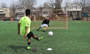 Players taking part in a soccer tournament in inner city Washington, DC. Critics argue expensive suburban leagues price out talent in poor neighbourhoods.