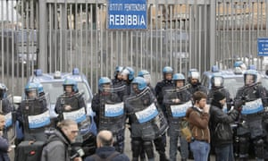 Police stand in front of the entrance of Rebibbia prison in Rome after inmates staged a protest against coronavirus containment measures