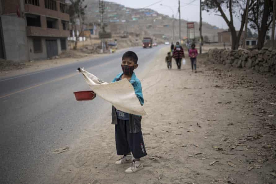 Keyler Martinez begs on the outskirts of Lima