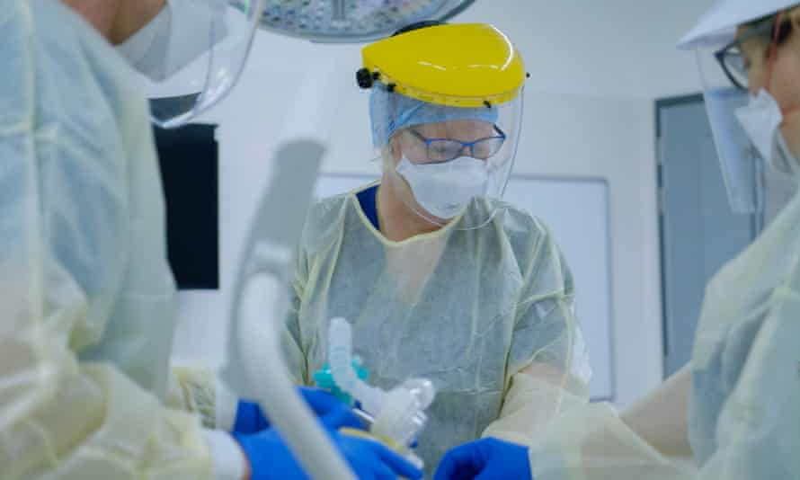 Medical workers take part in training for treating COVID-19 patients
