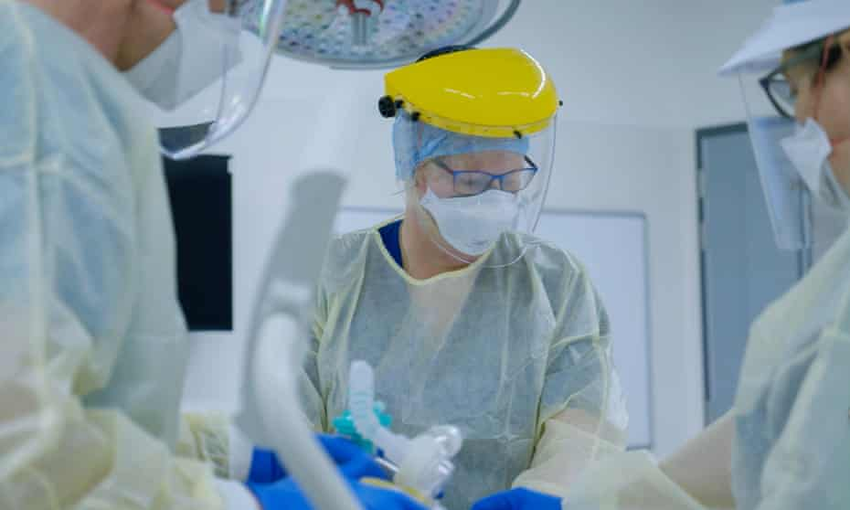 Medical workers take part in training for treating Covid-19 patients at a hospital in Auckland, New Zealand.