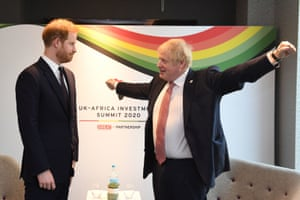 London, UK. The Duke of Sussex speaks to the PM, Boris Johnson, as they attend the UK-Africa investment summit at the InterContinental hotel