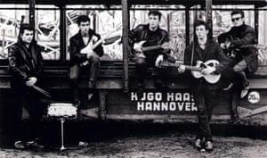 The Beatles in an early shot by Kirchherr; L-R: Pete Best, George Harrison, John Lennon, Paul McCartney, Stuart Sutcliffe - posed at Hamburg funfair.