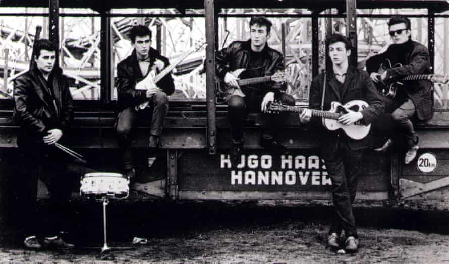 The Beatles in an early shot by Kirchherr; L-R: Pete Best, George Harrison, John Lennon, Paul McCartney, Stuart Sutcliffe - posed at Hamburg funfair.