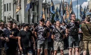 Soldiers, veterans and supporters of Azov Battalion hold a protest at the Ukrainian parliament in 2019. Some members of the group are involved in far-right MMA events