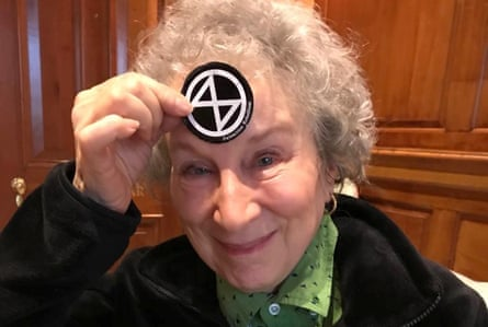 Canadian author Margaret Atwood holds up XR sticker.